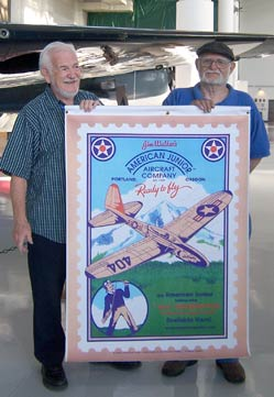 Gil Coughlin and Frank Macy holding a picture of the American Junior Interceptor Boy