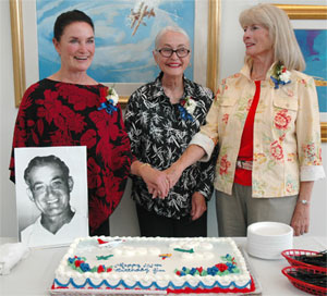 The three daughters of Jim Walker cut the birthday cake at the 101 celebration