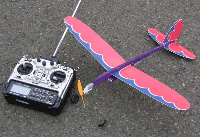 The radio transmitter and the RC Jim Walker Pursuit are ready to fly